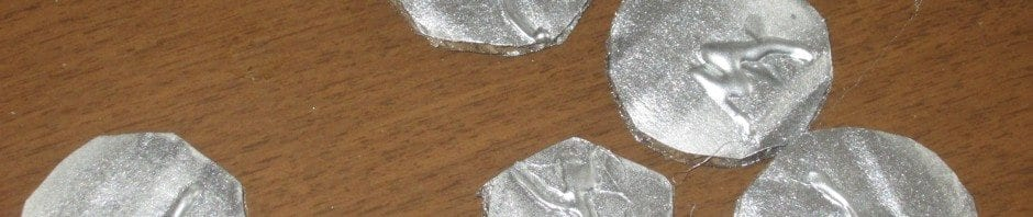 Viking Coins: Silver spray paint and hot glue on cardboard disks.