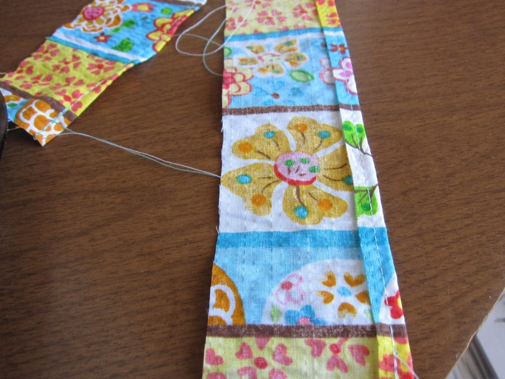 Use some scraps to make strips to sew on the cuffs of the dress.