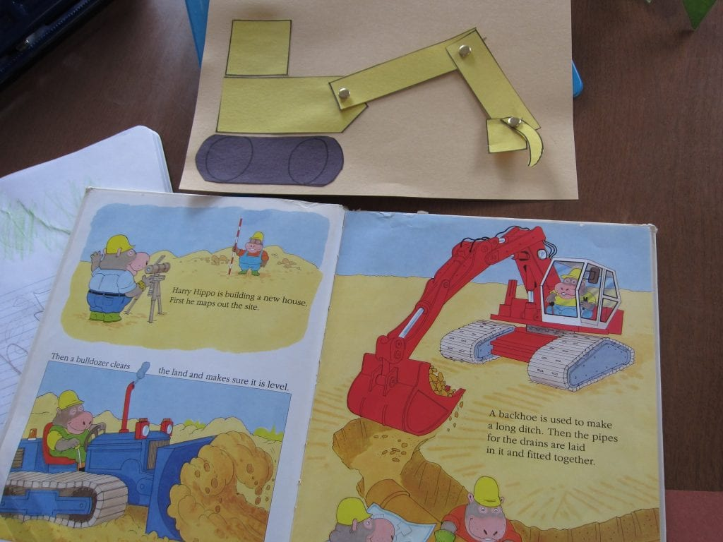 Paper backhoe with moving arm and bucket