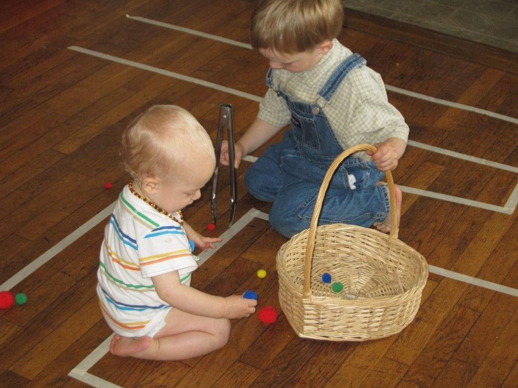 The little boys also had a turn. Jack was more interested in emptying the basket than filling it!