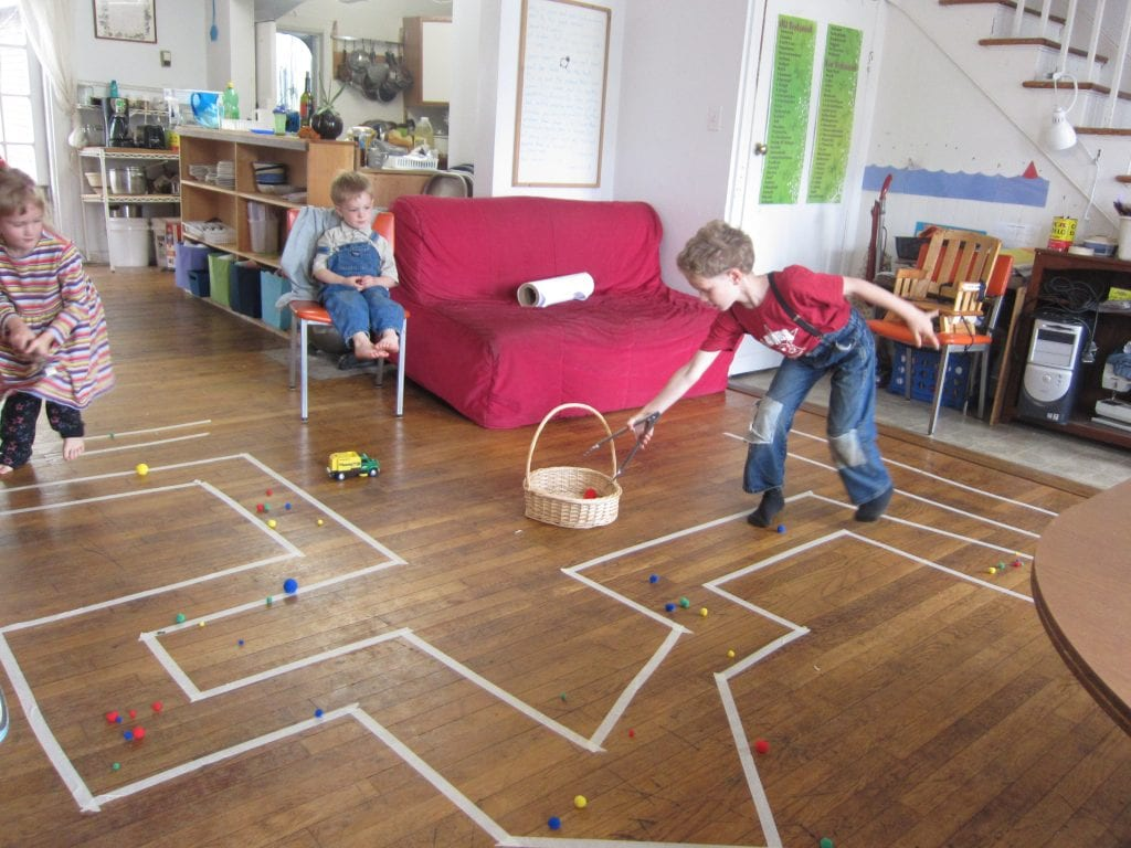 I laid out a maze all over the floor and set tasks for the children. Here Mouse and Buggle are racing to pick up pom-poms with salad tongs, without getting out of the lines!