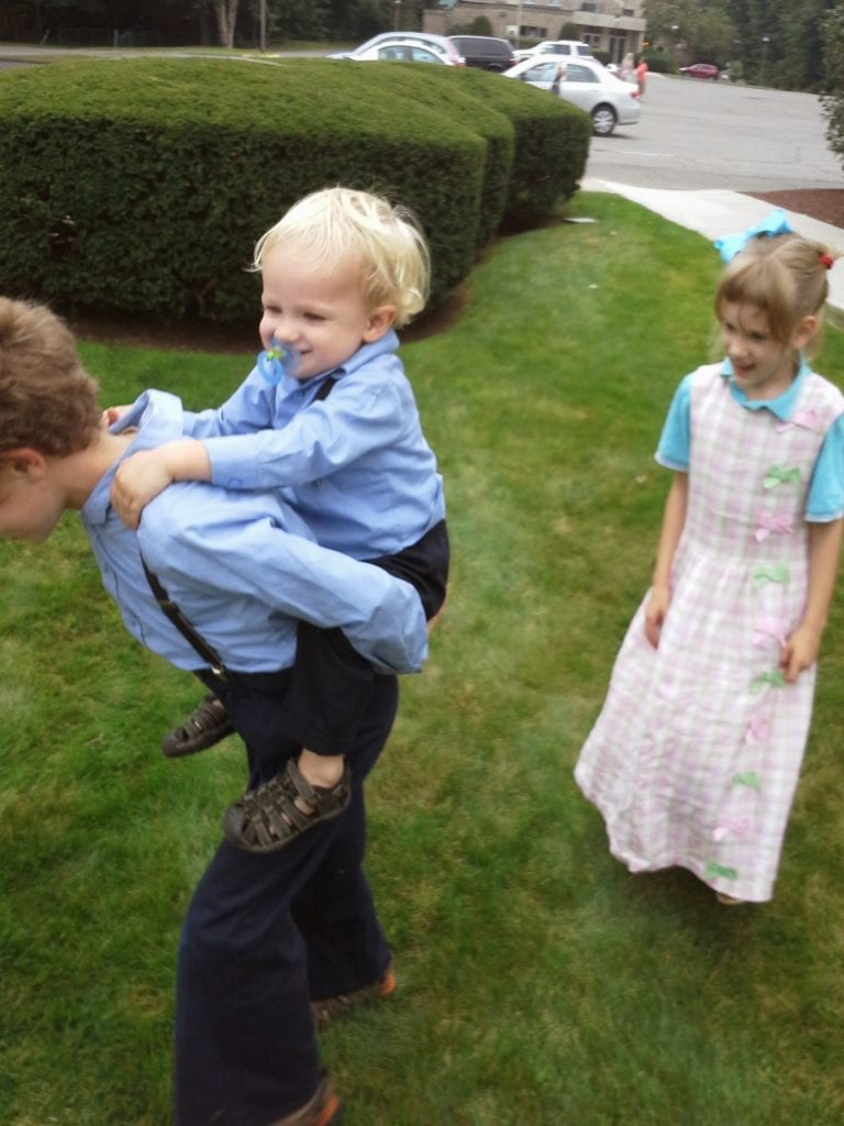 Children romping after church. Buggle is such a good big brother!