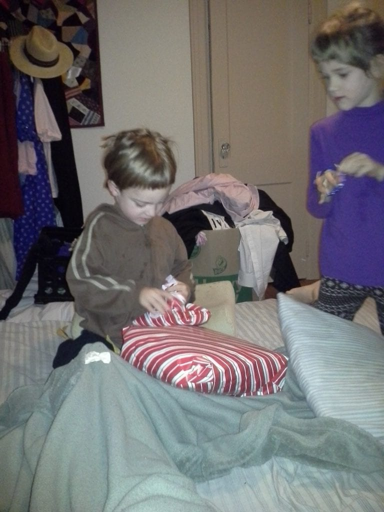 Opening his birthday present on my bed in the morning