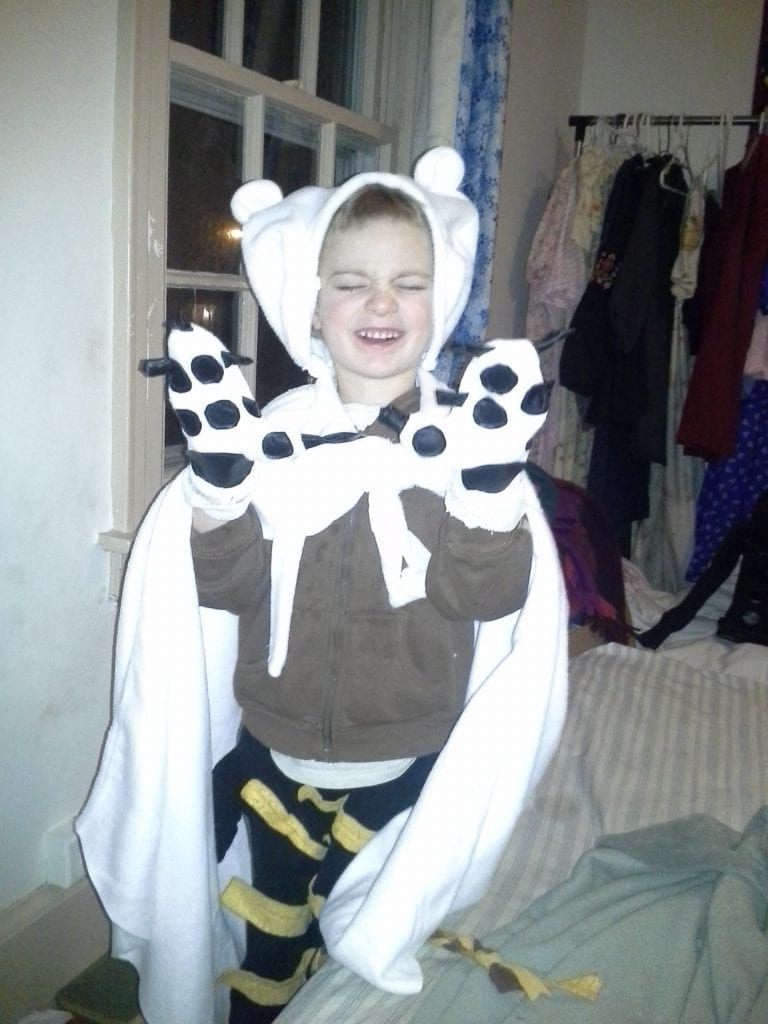 Polar Bear Cape and Paws! He will hardly take them off.