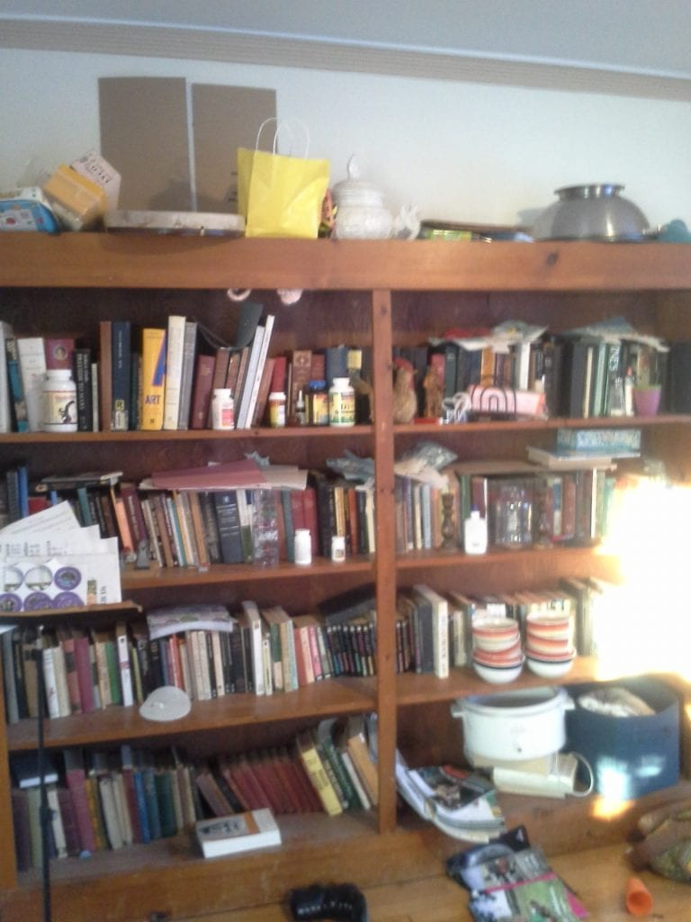 One of the great catch-all spaces in the house! If you can't find it where it belong look on the dining room shelves. Everything from bowls waiting for me to make a thrift store trip to stuff I've confiscated from the children and put up out of reach! Also more books, mostly from my college days, and our hymnal collection.