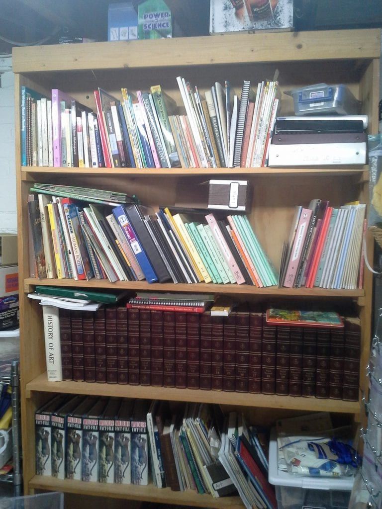 In the basement one shelf with homeschool materials- books no one is using right now, reference/ continuing ed stuff for me and the Encyclopedia Britannica my grandmother purchased for my Dad and his brothers (and yes we do use it!)