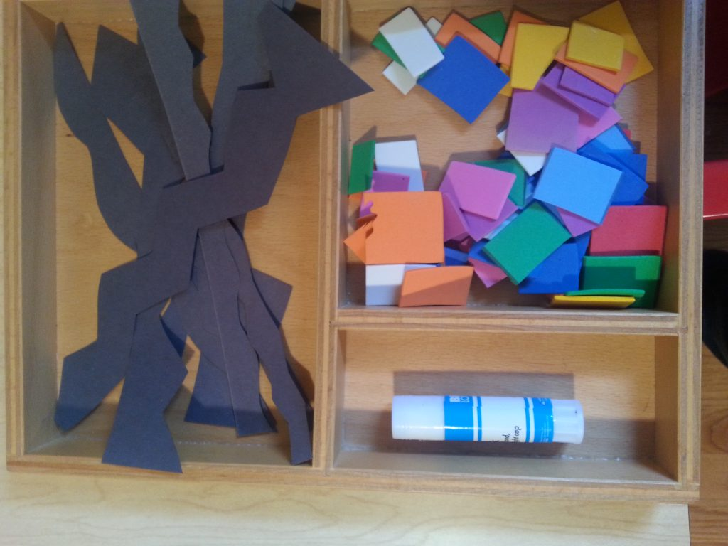 A supply of loose parts; foam squares and rectangles and wavy strips of construction paper.