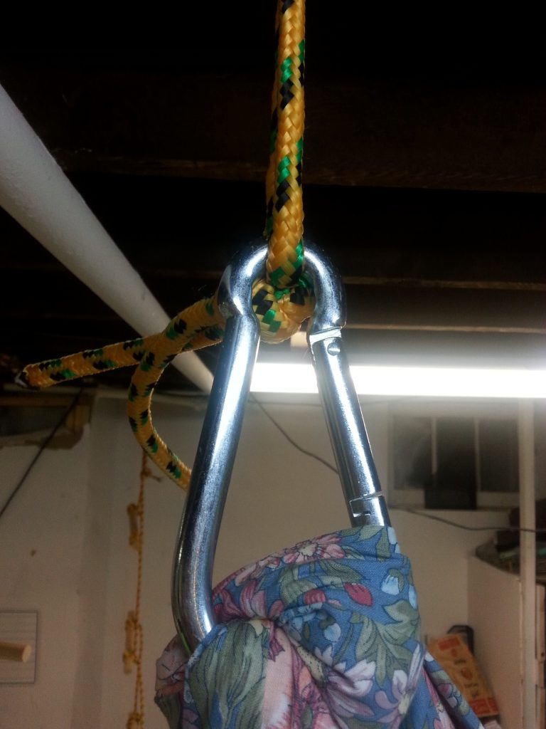 The fabric in the knots compressed quite a bit more than I expected so the swing is several inches lower than I wanted. I plan to retie it and start a couple of inches higher than I want the swing to hang to compensate.
